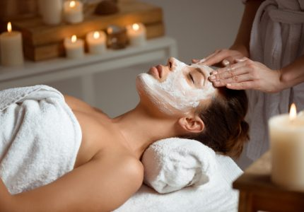 young-woman-in-mask-for-face-relaxing-in-spa-salon